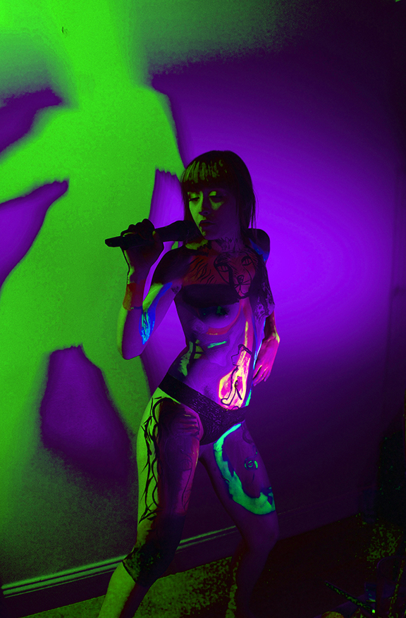 The Band Famous lead singer Norell performs wearing body paint by the artist and TBF member, Zander.